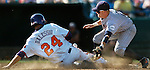 06/19/2006 Clemson's Andy D'Alessio steals second as the throw gets away from Cal State Fullerton's Justin Turner during the third inning of game nine of the College World Series in Omaha Nebraska Tuesday afternoon..(photo by Chris Machian/Prairie Pixel Group)