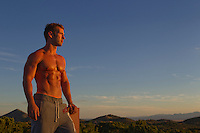 great looking man without a shirt at sunset in New Mexico