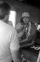 Dale Earnhardt with media garage Pepsi Firecracker 400 Daytona International Speedway Daytona Beach FL July 1987 (Photo by Brian Cleary/www.bcpix.com)