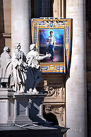 """A tapestry hanged on the facade of St Peter's basilica shows a portrait of Jose Sanchez del Río during a canonization mass.Pope Francis  leads a canonization mass on October 16, 2016 at St Peter's square in Vatican. Pope Francis canonises Argentine """"gaucho priest"""" Jose Gabriel Brochero today along with six others raised to sainthood : Salomon Leclercq, Jose Sanchez del Río, Manuel Gonzalez Garcia, Lodovico Pavoni, Alfonso Maria Fusco and Elizabeth of the Trinity."""