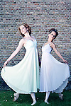 Two female ballet dancers wearing white dresses