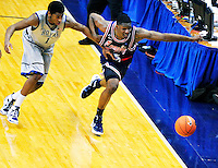 Hollis Thompson of the Hoyas and Adonis Thomas of the Tigers chase after the loose ball. Georgetown defeated Memphis 70-59 at the Verizon Center in Washington, D.C. on Thursday, December 22, 2011. Alan P. Santos/DC Sports Box