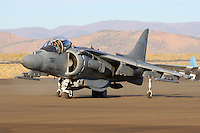 An AV-8B Harrier of the VX-9 Vampires taxis along the ramp at Stead Field in Nevada in September of 2007. Capable of vertical take off's and landings this subsonic fighter is utilized by the Marines as a light ground attack airplane. Powered by a Rolls Royce F402-RR-408 Pegasus vectored thrust turbofan the aircraft has a maximum speed of 629 mph with a range of 685 miles,  Based in China Lake, California, The VX-9 Vampires mission includes operational evaluation of attack, fighter, and electronic warfare aircraft, weapons systems and equipment, and to develop tactical procedures for their employment. Photographed September 2006.