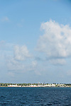 Kadhdhoo Island, Laamu Atoll, Maldives; commercial fishing boats docked at the harbor near a processing plant