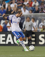 Montreal Impact midfielder Justin Mapp (21) takes a shot. In a Major League Soccer (MLS) match, Montreal Impact defeated the New England Revolution, 1-0, at Gillette Stadium on August 12, 2012.