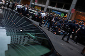 New York, New York<br /> October 14, 2011<br /> <br /> Owners of Zuccotti Park delayed a cleanup scheduled for Friday morning, averting a feared showdown between the police and the Occupy Wall Street demonstrators. <br /> <br /> Protesters, who have been occupying the park for three weeks, performed an intense clean up in the park as some held firm to stay while others appeared to be ready to move out. <br /> <br /> When the postponement was announced at 7AM the crowd surged and small bands marched towards Wall Street where the police arrested several in the crowd and the financial district became chaotic.<br /> <br /> The participants of the event, that began on September 17, are mainly protesting against social and economic inequality, corporate greed, and the influence of corporate money and lobbyists on government, among other concerns.