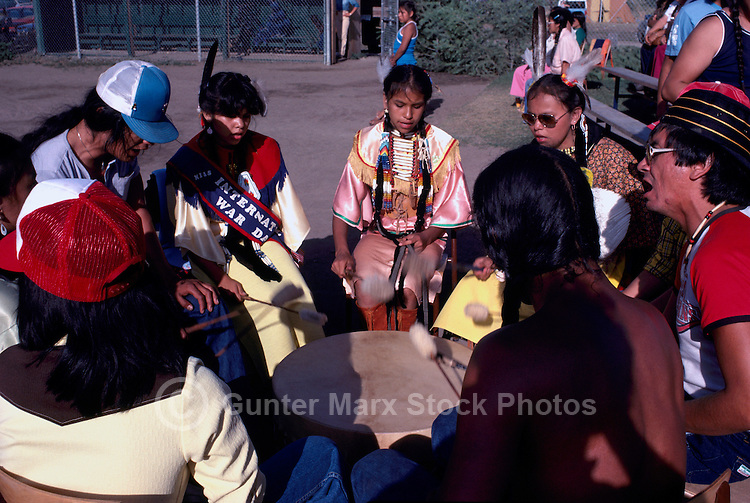 Native American Indian Drummers chanting and beating Drum at Pow Wow, BC, British Columbia, Canada