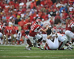 Arkansas quarterback Ryan Mallett (15) is sacked by Ole Miss defensive tackle LaMark Armour (94) at Reynolds Razorback Stadium in Fayetteville, Ark. on Saturday, October 23, 2010.