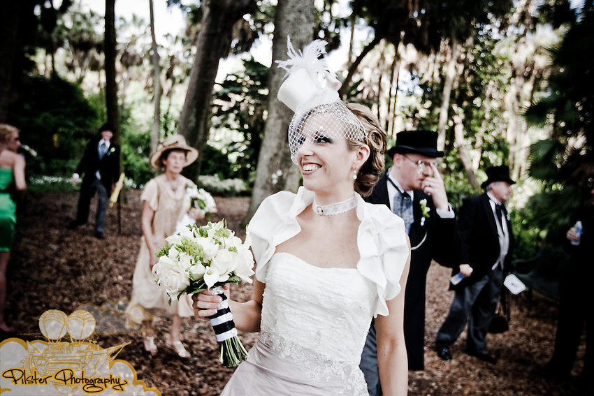 The wedding of Jessica Lillesand to Wade Baugher on Saturday, May 8, 2010, during an Alice in Wonderland themed day at Bok Tower Gardens in Lake Wales, Florida. Their day started in Lake Wales at the Holiday Inn Express, the ceremony at Bok Tower Gardens, and then mad tea party at Chalet Suzanne Inn and Restaurant. They then went to the Don Vicente De Ybor Historic? in Tampa, Florida and then they went to their second reception at the The Columbia Centennial Museum in Ybor City in Tampa, Florida.   (Chad Pilster, http://www.PilsterPhotography.net)