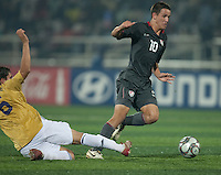 Luis Gil (10) dribbles past Koke (6).. Spain defeated the U.S. Under-17 Men National Team  2-1 at Sani Abacha Stadium in Kano, Nigeria on October 26, 2009.