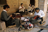 February 1975, Pokhara area, Nepal. Daily life. Street scene, shoe makers.