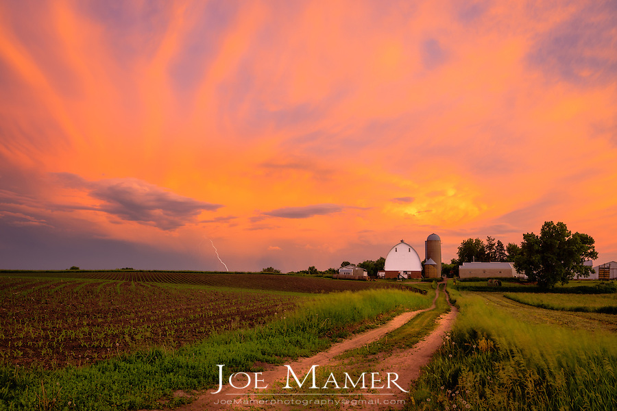 Sunset after summer thunderstorm over a Midwestern farm.