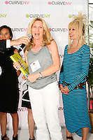 American Fashion Cookbook winner thanks presenter during charity raffle at the CURVE and CFDA Party For A Cause event during the CURVENY Lingerie & Swim show, at the Jacob Javits Convention Center, August 2, 2010.