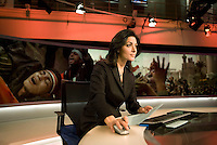 Newsreader Ghida Fakhry about to go live on air at news channel Al Jazeera in Doha.