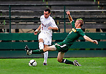 13 September 2009: University of Vermont Catamount backfielder Drew Smalley, a Sophomore from Beaverton, OR, slides to get the ball away from University of Massachusetts Minutemen midfielder Ben Arikian, a Junior from West Islip, NY, during the second round of the 2009 Morgan Stanley Smith Barney Soccer Classic held at Centennial Field in Burlington, Vermont. The Catamounts and Minutemen battled to a 1-1 double-overtime tie. Mandatory Photo Credit: Ed Wolfstein Photo