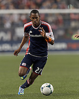 New England Revolution substitute forward Jerry Bengtson (27) dribbles. In a Major League Soccer (MLS) match, the New England Revolution (blue) tied New York Red Bulls (white), 1-1, at Gillette Stadium on May 11, 2013.