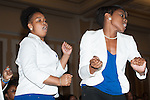 Kihresha Redinond and Rochelle Lewis, sorority members of Zate Phi Beta, perform during a lively stomp off held at the Multicultural Student Expo and Involvement Fair. Photo by Olivia Wallace