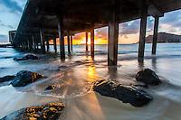 Sunrise behind the Makai Research Pier in Waimanalo, O'ahu.
