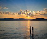 Idaho, North, Kootenai County, Coeur d'Alene. Sunset over Lake Coeur d'Alene, with Tubbs Hill right center.