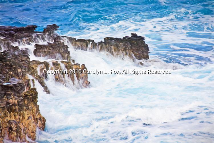 Waves crash against the rocks in Hawaii.