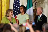 United States first lady Michelle Obama (C) shares a laugh with Irish Prime Minister Enda Kenny's wife, Fionnuala (L) and US Vice President Joe Biden during a reception in the East Room of the White House, March 20, 2012, in Washington, DC. President Obama and Kenny concluded a working day devoted to discussions on economic matters, Ireland's peace keeping participations and foreign policy issues like Syria and Iran.   .Credit: Mike Theiler / Pool via CNP