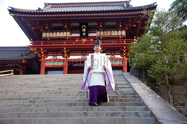 A priest walks down the 61 steps leading from the inner sanctuary during the annual Reitaisai Grand Festival at Tsurugaoka Hachimangu Shrine in Kamakura, Japan on  14 Sept. 2012.  Sept 14 marks the first day of the 3-day Reitaisai festival, which starts early in the morning when shrine priests and officials perform a purification ritual in the ocean during a rite known as hamaorisai and limaxes with a display of yabusame horseback archery. Photographer: Robert Gilhooly