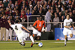 14 December 2007: Wake Forest's Julian Valentin (4) defends against Virginia Tech's Patrick Nyarko (GHA) (12) as Evan Brown (18) watches. The Wake Forest University Demon Deacons defeated the Virginia Tech University Hokies 2-0 at SAS Stadium in Cary, North Carolina in a NCAA Division I Men's College Cup semifinal game.