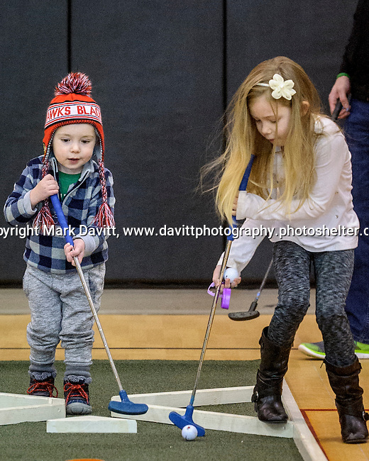 Could be hockey or it could be a new kind of team golf. Logan and Alivia Dylo team up on getting their ball in the hole. The fourth annual 4th Altoona Elementary Golf in the Halls was held Jan. 28. Participants enjoyed a breakfast and  two, 18-hole mini-golf courses throughout the school's classrooms, hallways and gymnasiums.