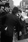 Young man in the Kings Road, Chelsea London 1977, being given a friendly warning by the police.