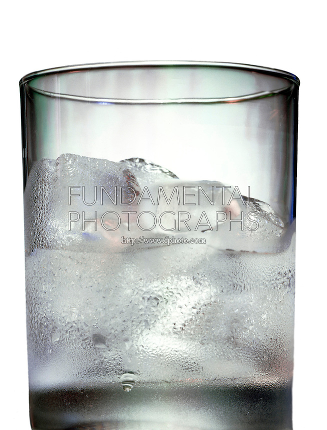 ICE MELTING IN A GLASS WITH CONDENSATION<br /> Water Freezes At 0 Deg C. Or 32 Deg F At 1 Atm