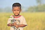 In Khnach, a village in the Kampot region of Cambodia, a child prepares to plant a tree, part of a reforestation project for preschool children sponsored by the Cambodian Children's Advocacy Foundation.