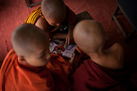 During their free time, many young monks could be found catching up on football news.