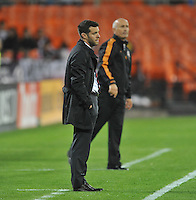 D.C. United Head Coach Ben Olsen and in the background Houston Dynamo head coach Dominic Kinnear. The Houston Dynamo defeated D.C. United 4-0, at RFK Stadium, Wednesday May 8 , 2013.