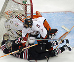 2/6/04 Omaha, NE University of Nebraska at Omaha's Ryan Bennett scores a goal against  Bowling Green University goalie Jonathan Sigalet while No. 7 Kevin Bieksa defends.<br /> <br /> (Chris Machian/Prairie Pixel Group)