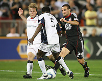 Brandon Barklage #24 of D.C. United tries to get past Seth Sinovic #27 and Emmanuel Osei #5 of the New England Revolution during an MLS match on April 3 2010, at RFK Stadium in Washington D.C.