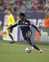 New England Revolution forward Kenny Mansally (7) dribbles. In a Major League Soccer (MLS) match, the New England Revolution tied the Colorado Rapids, 0-0, at Gillette Stadium on May 7, 2011.