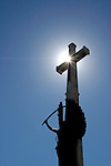 Sun shining behind cross outside Christchurch Cathedral, Christchurch, New Zealand