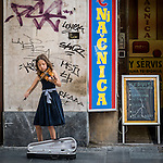 A young girl plays her violin on the street for tips, Kneza Mihaila, downtown, Belgrade, Serbia