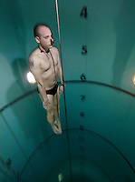 Bjarte Nygaard on his way up from a dive.  Freediving in a tank belonging to Royal Norwegian Navy Diving School at Haakonsvern Naval base, Norway.