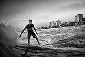Amer Al Dous, 16, rides a wave off the shore of Gaza City, Gaza Strip. Surfing offers a mean of escape from the daily struggles of life under blockade in Gaza.