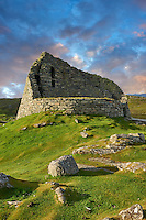 Pictures of Dun Carloway Broch on the Isle of Lewis in the Outer Hebrides, Scotland. Brochs are among Scotland's most impressive prehistoric buildings and were the precursors of the Medieval Scottish Tower Houses. The world Broch is derived from lowland scots who called forts Brough from the old Norse Borg. <br />