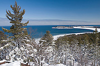 A view of Lake Superior from atop Sugarloaf Mountain in winter near Marquette Michigan in the Upper Peninsula.