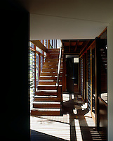 Wood is used throughout the house and the louvered windows which flank the staircase allow air to circulate easily