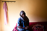 Hawa, a political leader in the SPLM sits in her hotel  in the Nuba Mountains on July 6, 2011, She was forced to flee from a camp in Kadulgli next to the UN compound after members of the Public Defense Froces started shooting anyone associated with the SPLM in front of her.