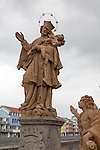 Religious statues on Old Bridge, the oldest bridge in the Czech Republic, the town of Písek, Czech Republic, Europe
