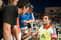 Chris Pontius (13) of DC United talks with fans after the match. DC United defeated Philadelphia Union 1-0 during a Major League Soccer (MLS) match at PPL Park in Chester, PA, on June 16, 2012.