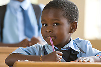Young girl in a school classroom in the small village of Usa River, Tanzania, East Africa