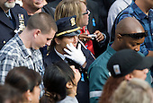 A New York City police officer attends the Commemoration Ceremony at the National September 11 Memorial at the World Trade Center Site in New York, New York on September 11, 2011. .Credit: Kristoffer Tripplaar / Pool via CNP