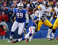 ORCHARD PARK, NY - NOVEMBER 28:  Mewelde Moore #21 of the Pittsburgh Steelers runs with the ball through a tackle by Leodis McKelvin #28 of the Buffalo Bills during the game on November 28, 2010 at Ralph Wilson Stadium in Orchard Park, New York.  (Photo by Jared Wickerham/Getty Images)