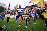 Tom Dunn of Bath Rugby, mascot in hand, runs out onto the field. Aviva Premiership match, between Bath Rugby and Saracens on December 3, 2016 at the Recreation Ground in Bath, England. Photo by: Patrick Khachfe / Onside Images